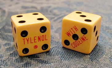 """Vintage doctor's swag - craps dice advertise Tylenol with Codiene"" by Woodly Wonderworks via Flickr"